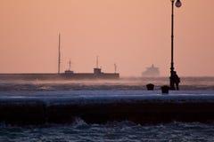 在的里雅斯特冷淡的码头的晚上  库存图片