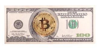 在的金黄bitcoin美元 库存照片