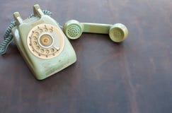 在皮革的老电话 库存图片