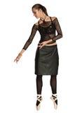 在皮革黑色裙子的跳芭蕾舞者 图库摄影