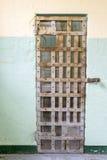 在监狱的牢房门 库存图片