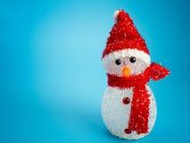 在盔甲的雪人建造者 快活的圣诞节 库存图片