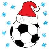 在盖帽的圣诞节橄榄球 库存照片