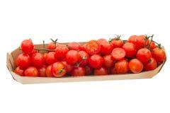 在盘子的新鲜的红色鸡尾酒蕃茄 库存照片