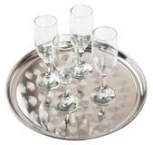 在盘子的许多香槟玻璃 库存照片