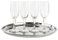 在盘子的许多香槟玻璃 免版税库存图片