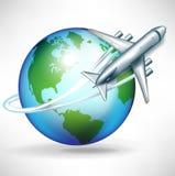 在盘旋的地球附近的飞机 库存图片