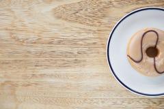 在盘的油炸圈饼 免版税图库摄影