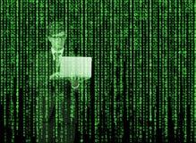 在矩阵样式的数字式全息图 有膝上型计算机的一个人在互联网浏览数据 图库摄影