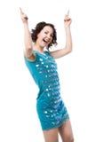 在短的发光的蓝色礼服的活跃少妇跳舞 库存图片