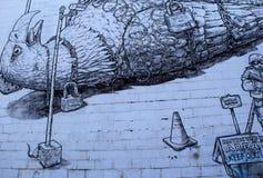 在石大厦,罗切斯特,纽约墙壁上绘的政治图象的大鸟被囚禁, 2017年 图库摄影