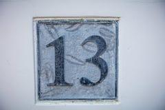 在石头和白色背景的第13 免版税图库摄影