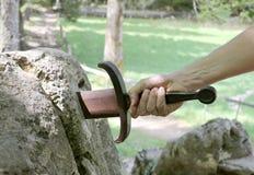 在石头的Excalibur剑 库存照片