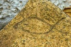 在石头的Ichthus基督徒标志 免版税库存图片
