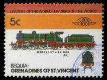 在石榴汁糖浆打印的邮票圣文森特展示泽西百合火车4-4-2 免版税库存图片