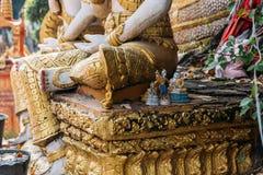 在石头的亚洲精神玩偶在老挝寺庙在万象,老挝 免版税库存照片