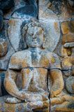 在石头encarved的坐的菩萨,婆罗浮屠 免版税库存图片