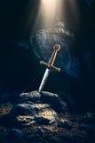 在石excalibur的剑 免版税图库摄影
