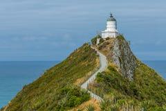 在矿块点新西兰的灯塔 免版税库存照片