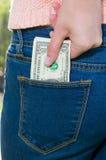 在矿穴的货币 免版税库存照片