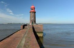 在码头的灯塔 免版税库存照片