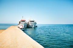 在码头的两条小船 免版税图库摄影