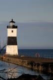 在码头的灯塔 库存照片