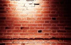 在砖墙上的一个亮点 库存照片
