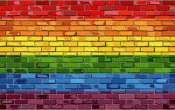 在砖墙上的同性恋自豪日旗子 免版税库存图片