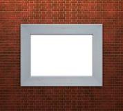 在砖墙上的框架 免版税库存图片