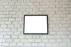 在砖墙上的框架 免版税图库摄影