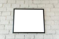 在砖墙上的框架 库存照片