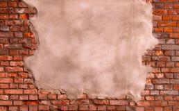 在砖墙上的灰泥 免版税库存图片