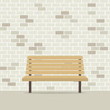 在砖墙上的空的椅子 免版税库存图片