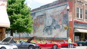 在砖墙上的老壁画 库存图片