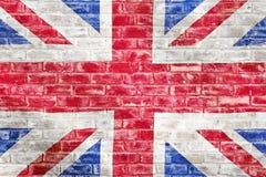 在砖墙上的英国旗子 免版税库存图片