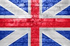 在砖墙上的英国旗子 免版税库存照片