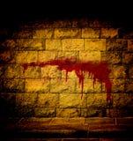 在砖墙上的血液 免版税库存图片