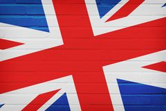在砖墙上绘的英国旗子 免版税库存照片