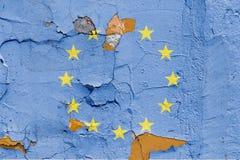 在砖墙上绘的欧盟旗子 欧洲标志联盟 被构造的抽象背景 免版税库存图片