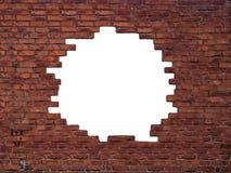 在砖墙的大孔 免版税图库摄影