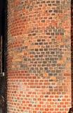 在砖墙的曲线 库存图片