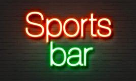 在砖墙背景的娱乐酒吧霓虹灯广告 免版税库存图片