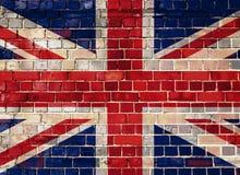 在砖墙背景的英国标志 免版税图库摄影