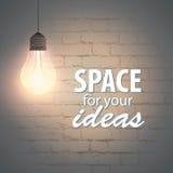 在砖墙背景的辉光灯与您的文本的空间 免版税图库摄影