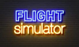 在砖墙背景的飞行防真器霓虹灯广告 库存照片
