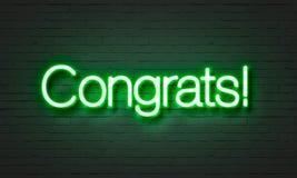 在砖墙背景的Congrats霓虹灯广告 免版税图库摄影