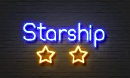 在砖墙背景的Starship霓虹灯广告 库存图片