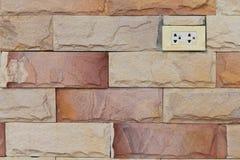 在砖的插座 免版税库存照片