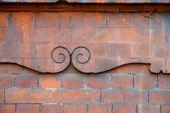 在砖砌的装饰Curlicues 库存照片